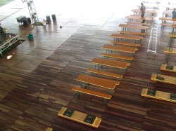 Beer hall tables and tongue in groove hardwood flooring